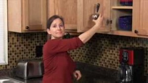 video capture of Elisa Bernick explaining how to organize kitchen measuring cups